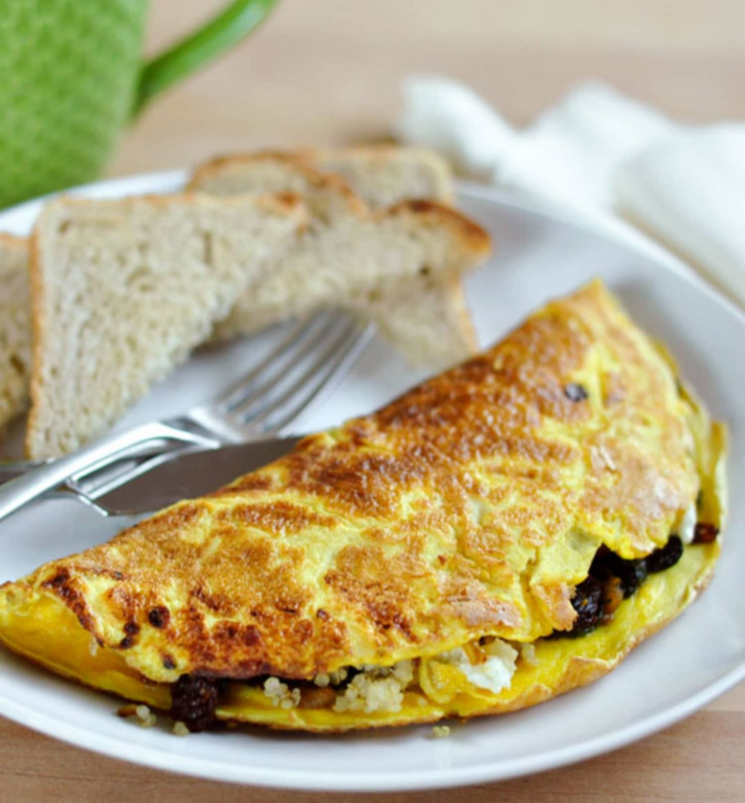 9-Egg Omelet with Quinoa, Sun-Dried Tomatoes, Spinach, and Goat Cheese - Recipes Egg Omelet