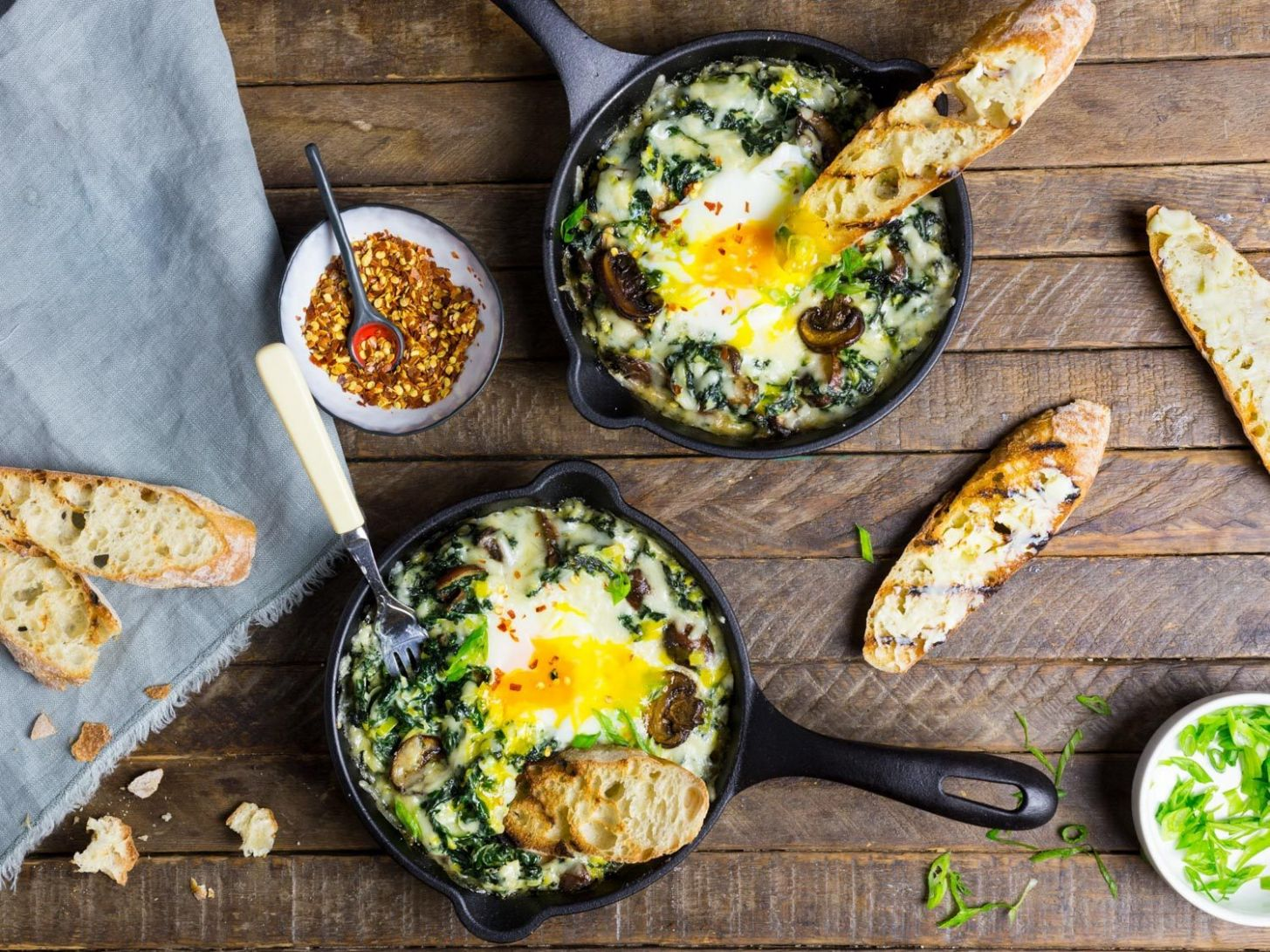 Baked Eggs With Creamy Greens, Mushrooms, and Cheese Recipe