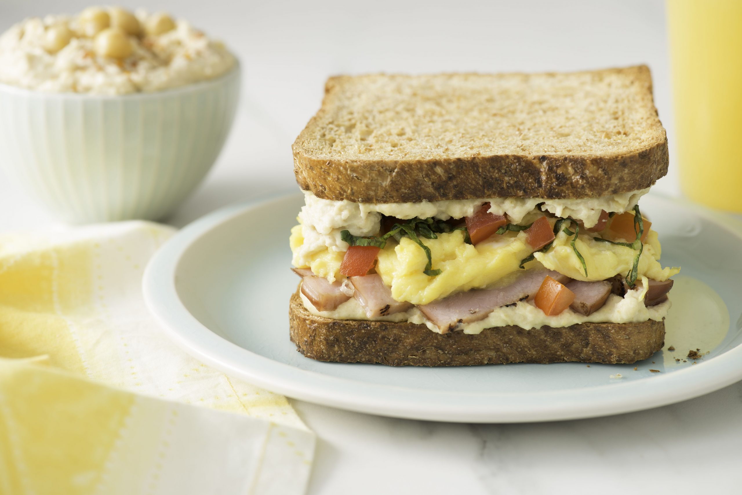 Breakfast Sandwich with Hummus, Scrambled Eggs and Tomato - Sandwich Recipes With Nutritional Value