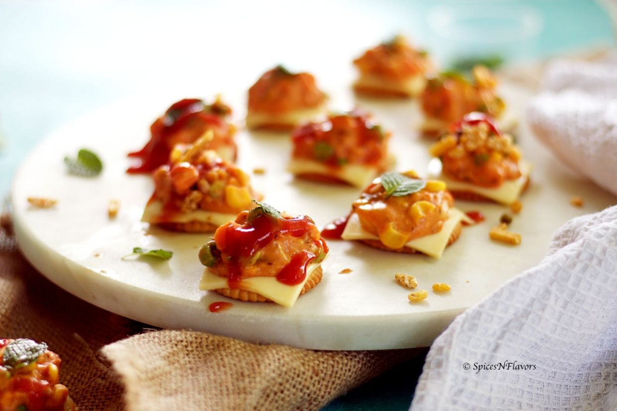Cheesy Monaco Bites - Monaco Biscuit Party Topping recipe - Recipes Dinner Party Starters
