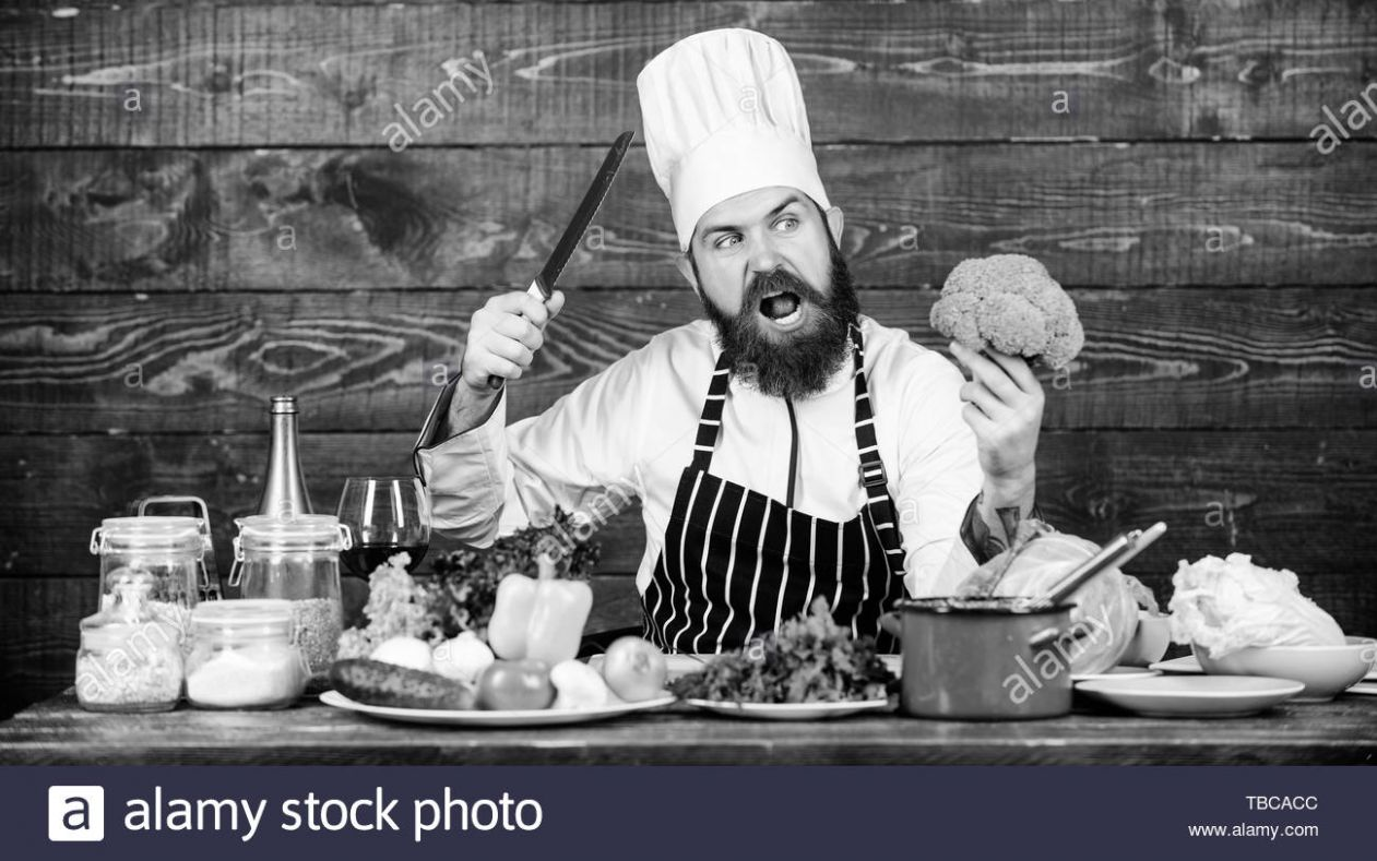 Culinary recipe concept. Man bearded hipster cooking fresh ...