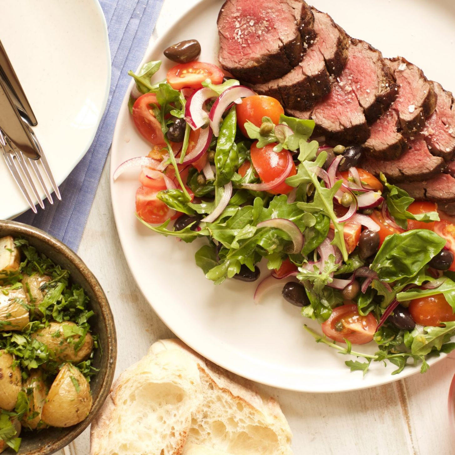 Eye Fillet with Mediterranean Salad and Herby New Potatoes