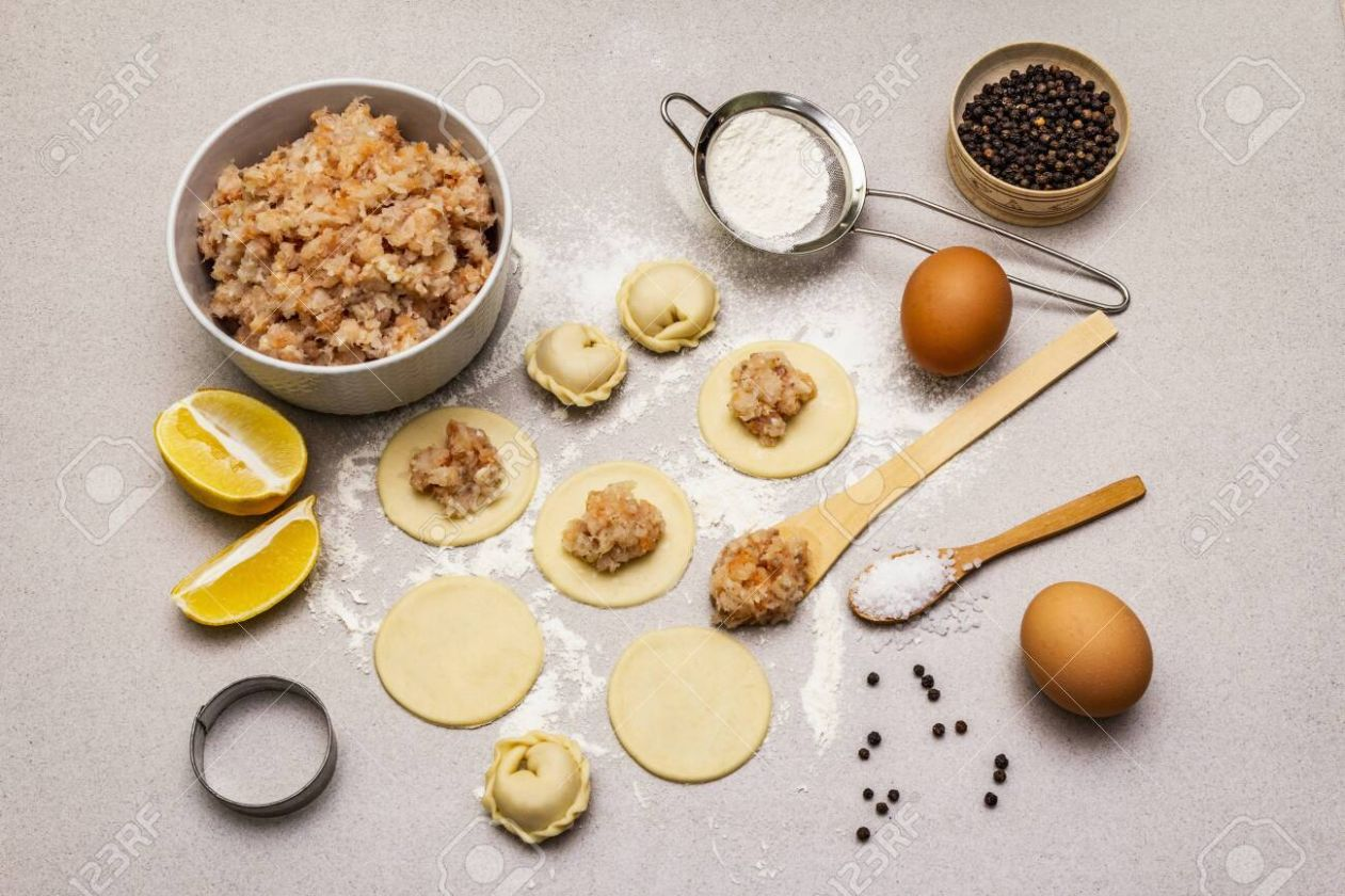 Fish dumplings. Ingredients for home cooking. Fresh dough, fish,.