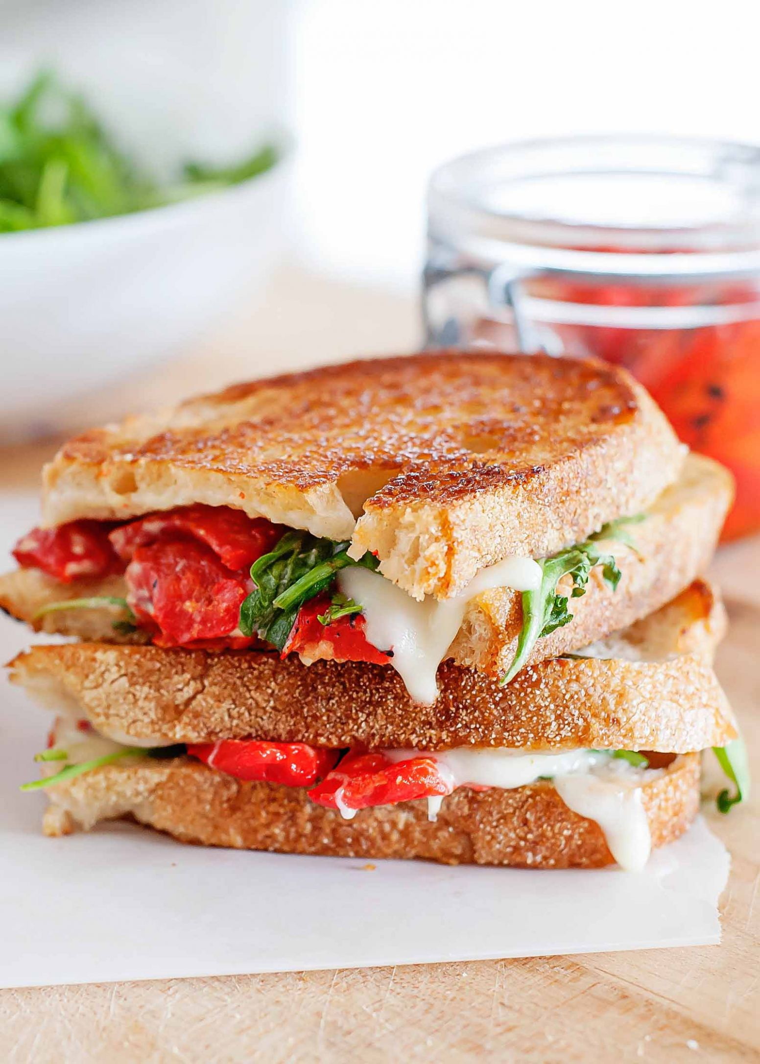 Grilled Cheese Sandwich with Mozzarella, Red Peppers, and Arugula