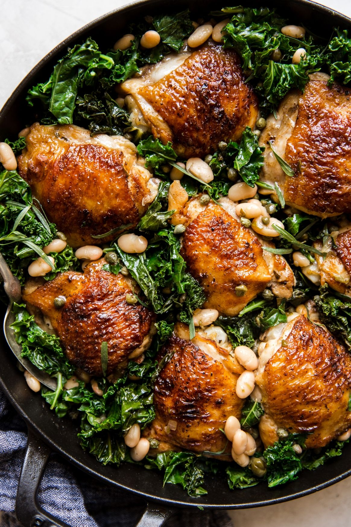 One-Pot Braised Chicken with Kale and White Beans