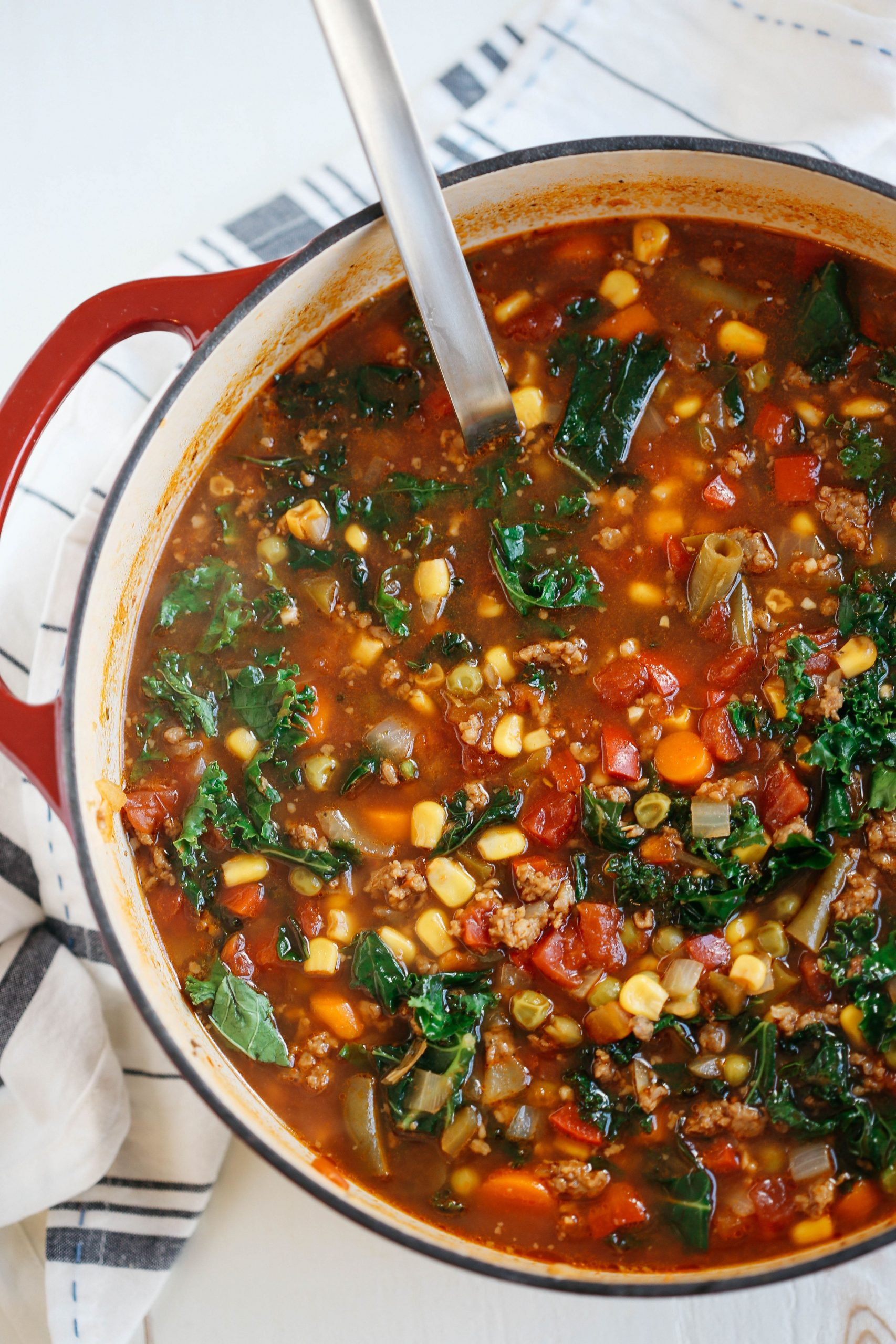 One Pot Spicy Sausage and Kale Soup