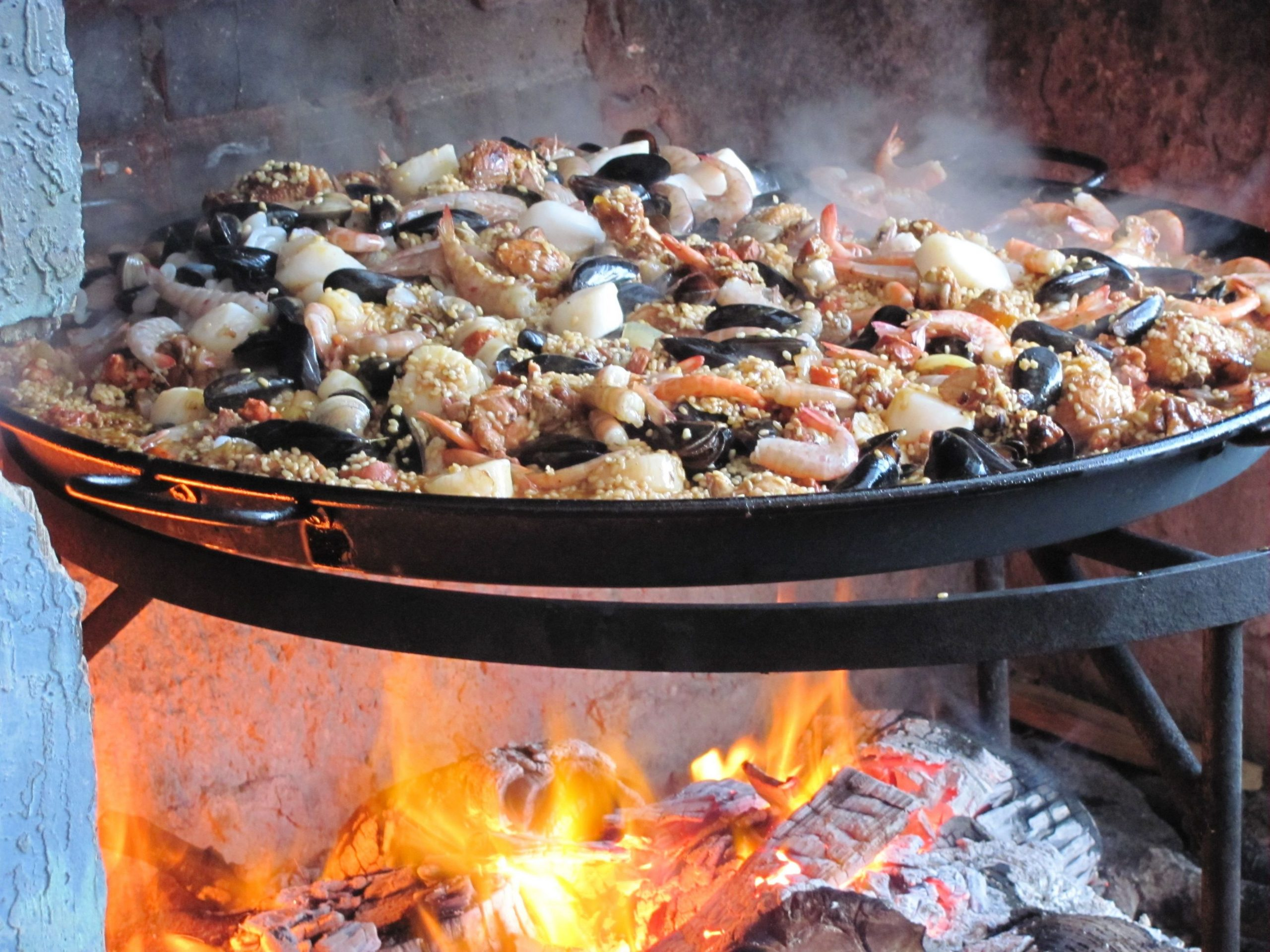 Open fire cooked paella | Cooking over fire, Open fire cooking ...