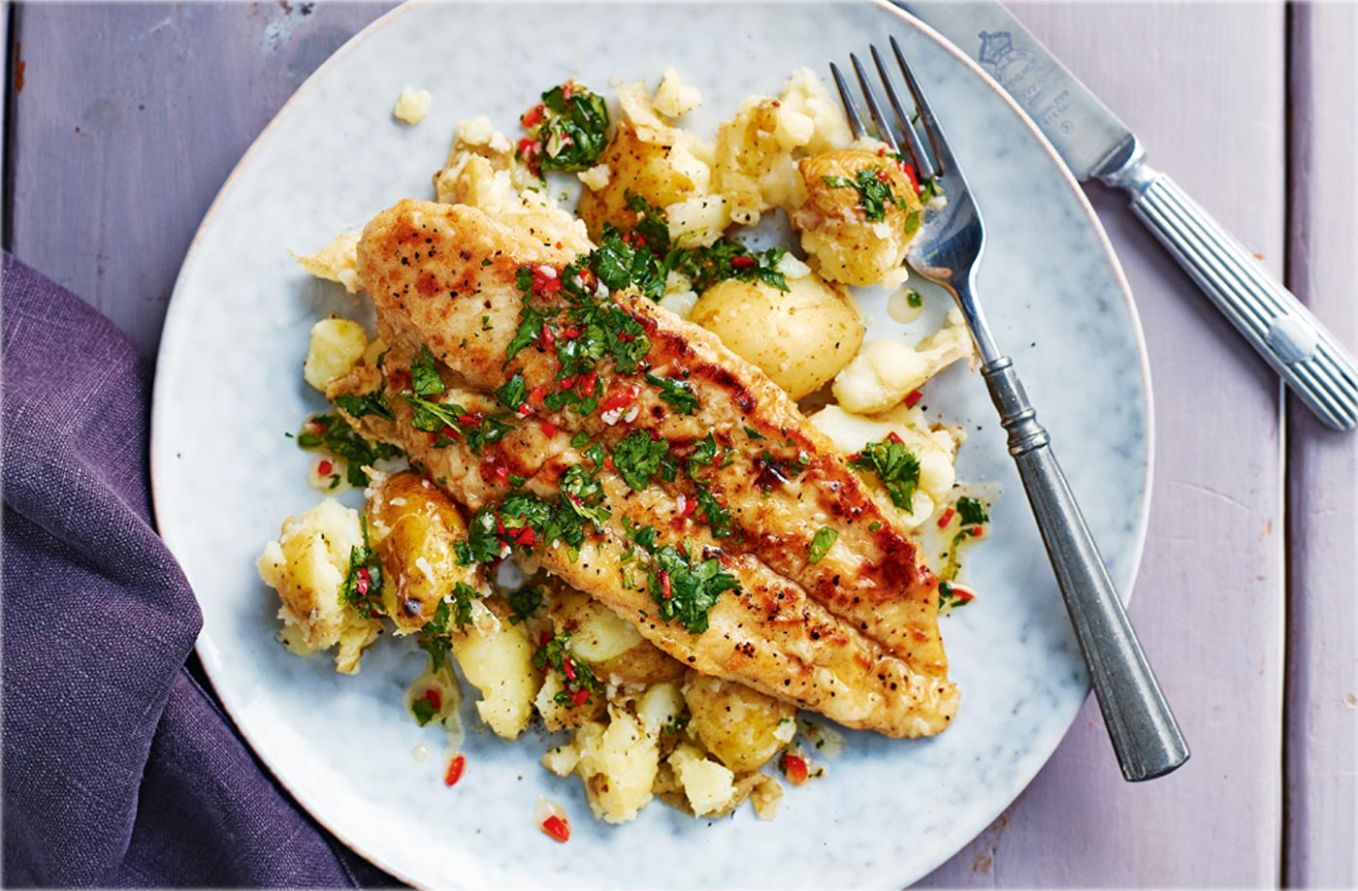 Pan-fried basa fillets with garlic potatoes