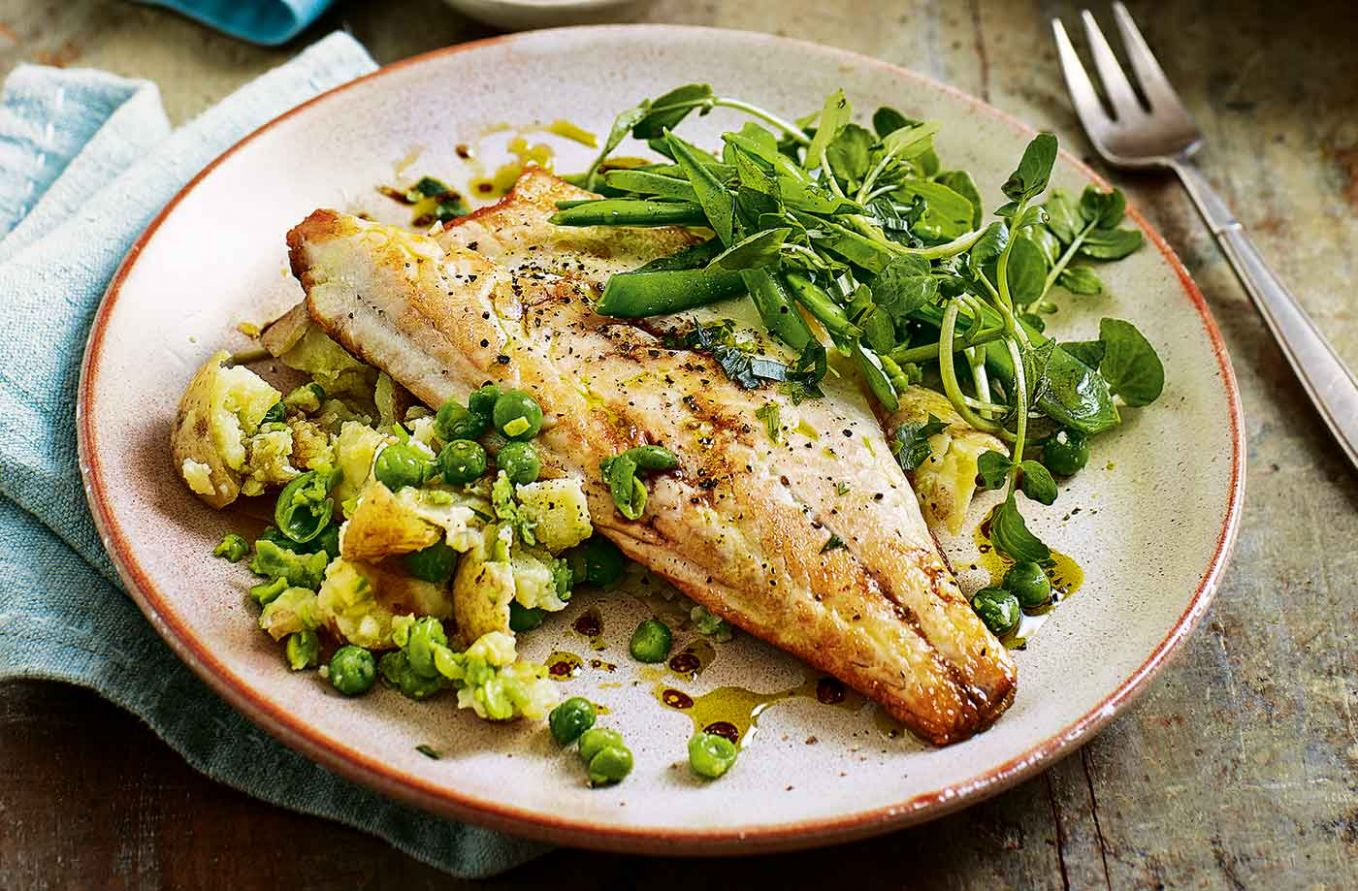 Pan-fried sea bass with pea and potato salad