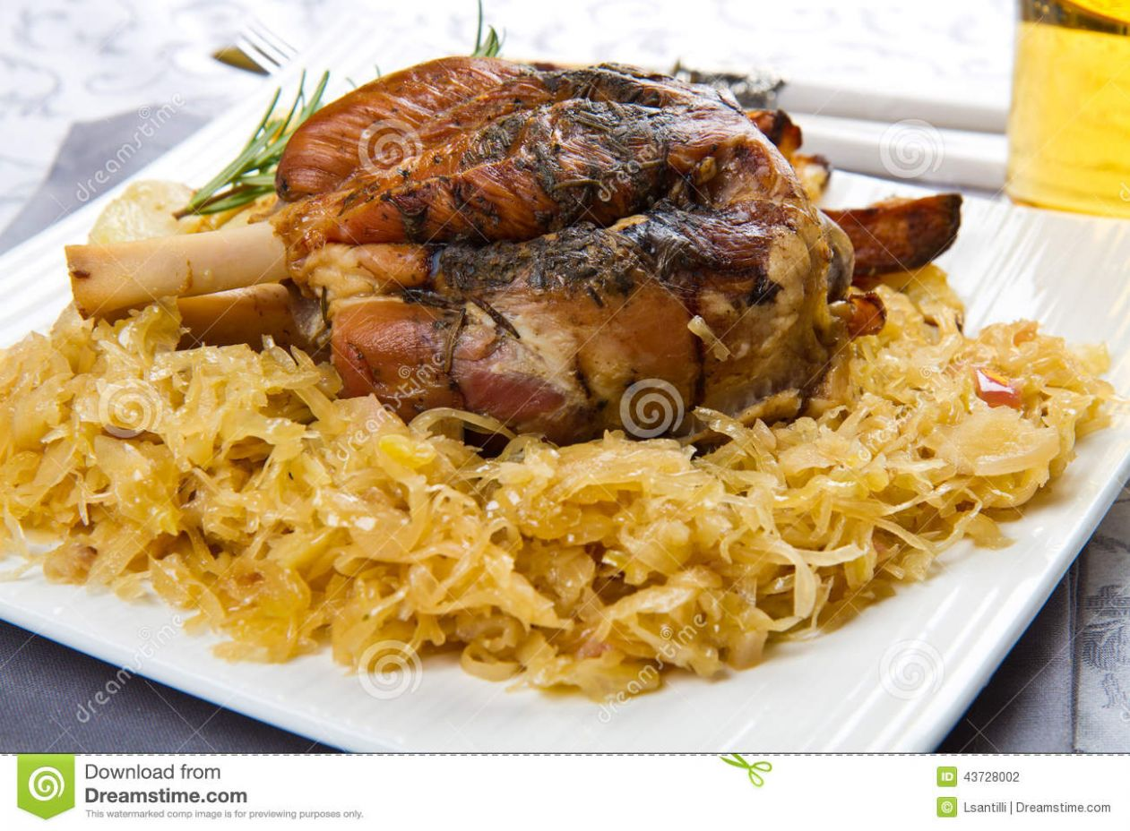 Pork Knuckle Baked With Sauerkraut Stock Photo - Image of ...