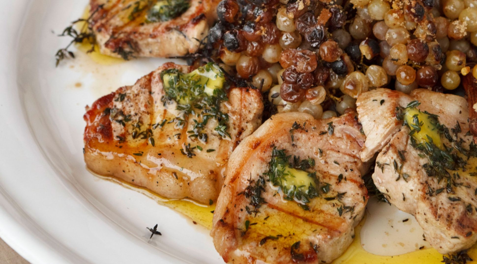 Pork Loin Chops with Thyme Oil and Roasted Grapes on the Vine - Recipes Pork Loin Chops