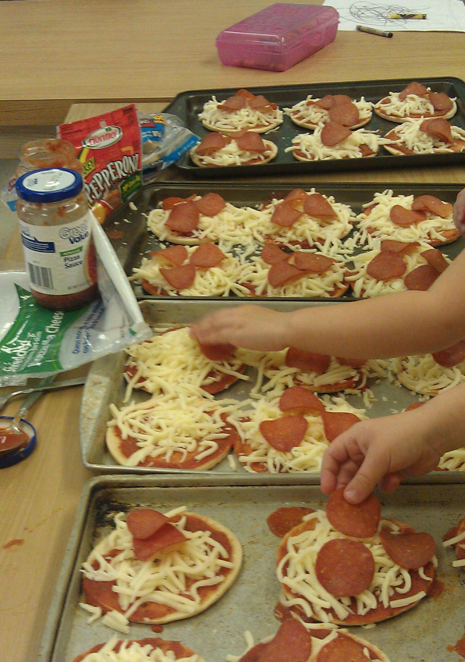 Preschool Style Pizza Party! Sandwich Thins, pizza sauce, cheese ..