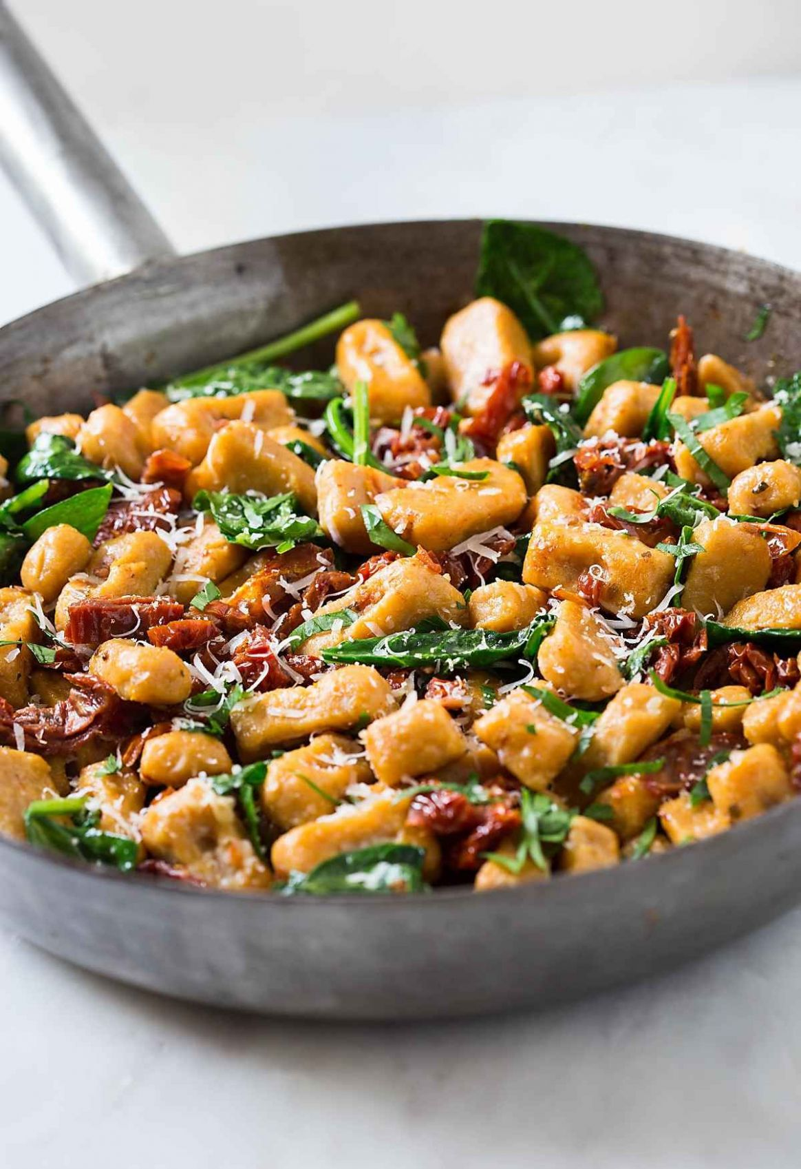 Quick and Easy Sweet potato gnocchi with spinach and sun-dried tomatoes - Recipes Using Potato Gnocchi