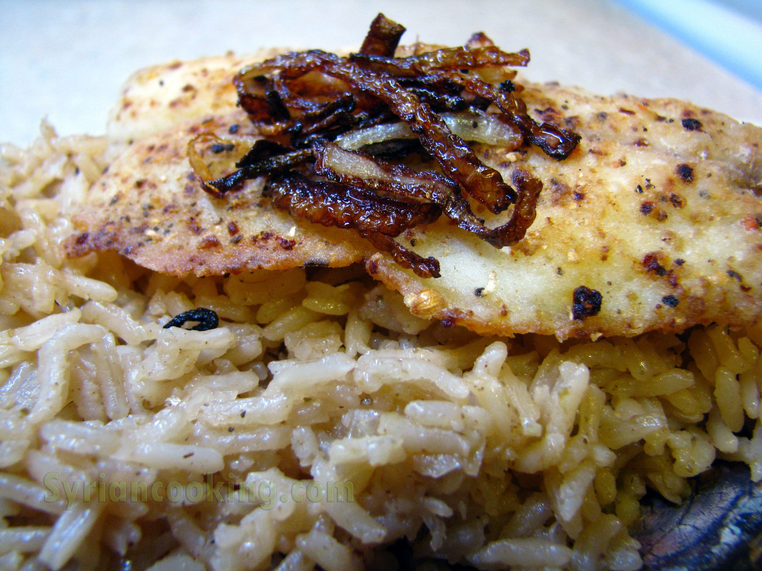 Sayadieh (Fish With Spiced Rice And Caramelized Onions)