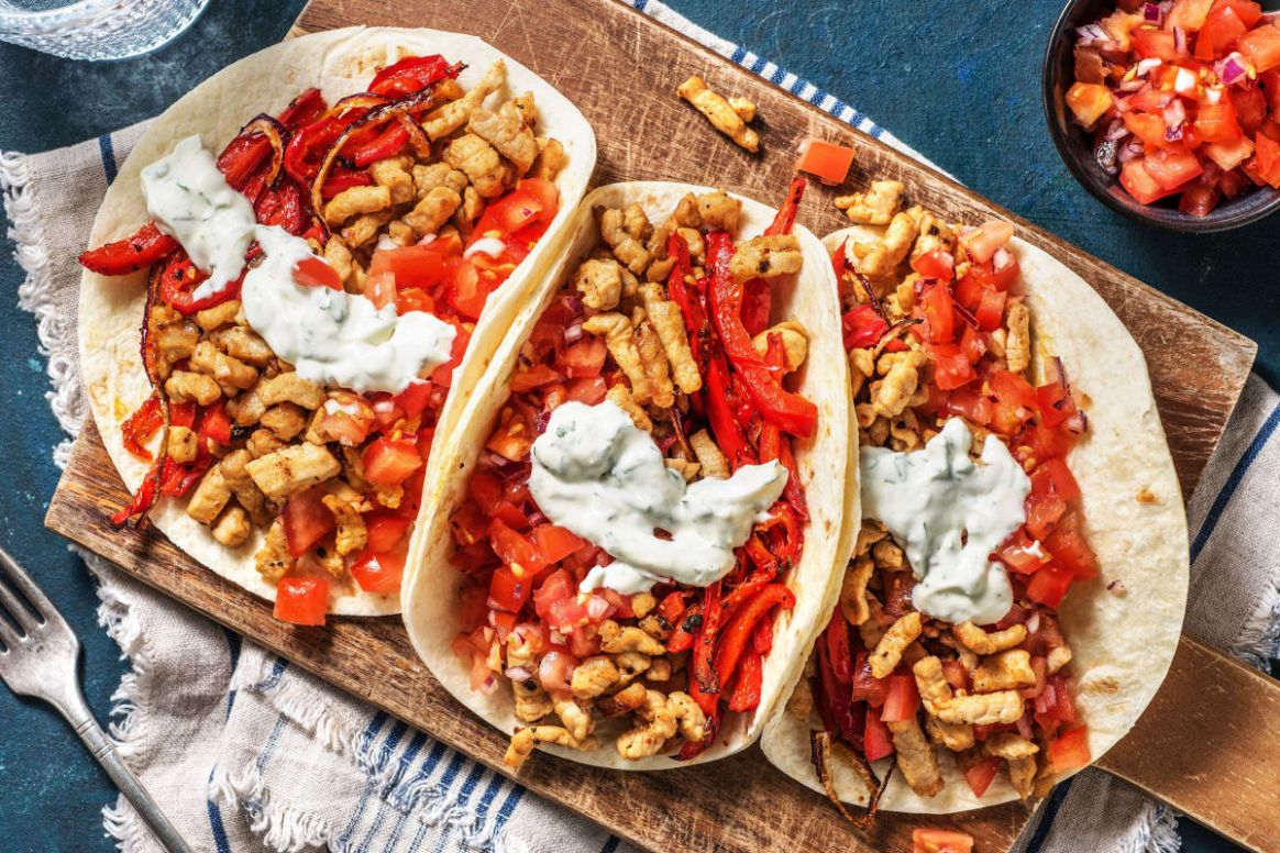 Sizzling Pork Fajitas with Roasted Peppers, Lime Crema and Salsa Fresca