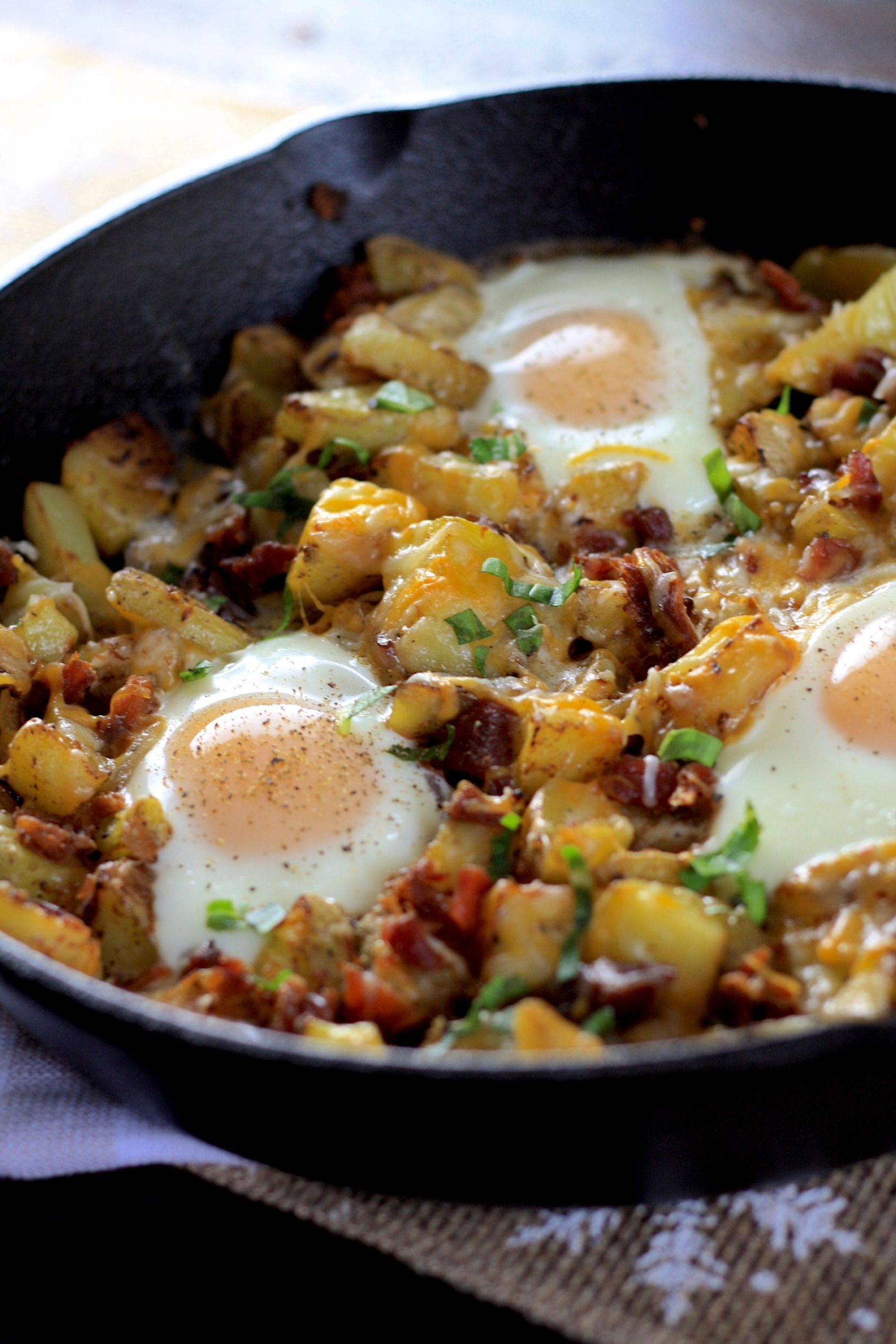 Skillet Baked Eggs with Country Potatoes and Bacon