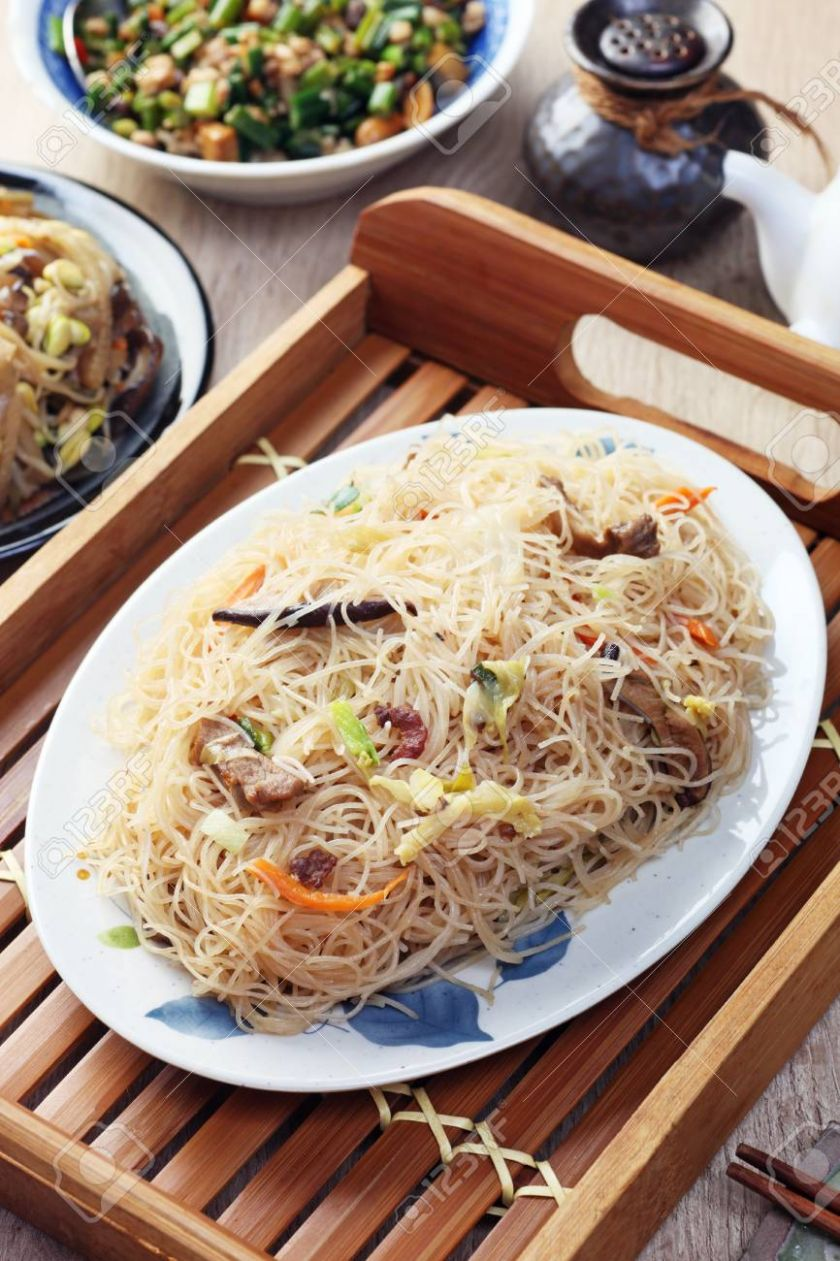 Stir fry rice noodles with vegetables, mushrooms, cabbage and.