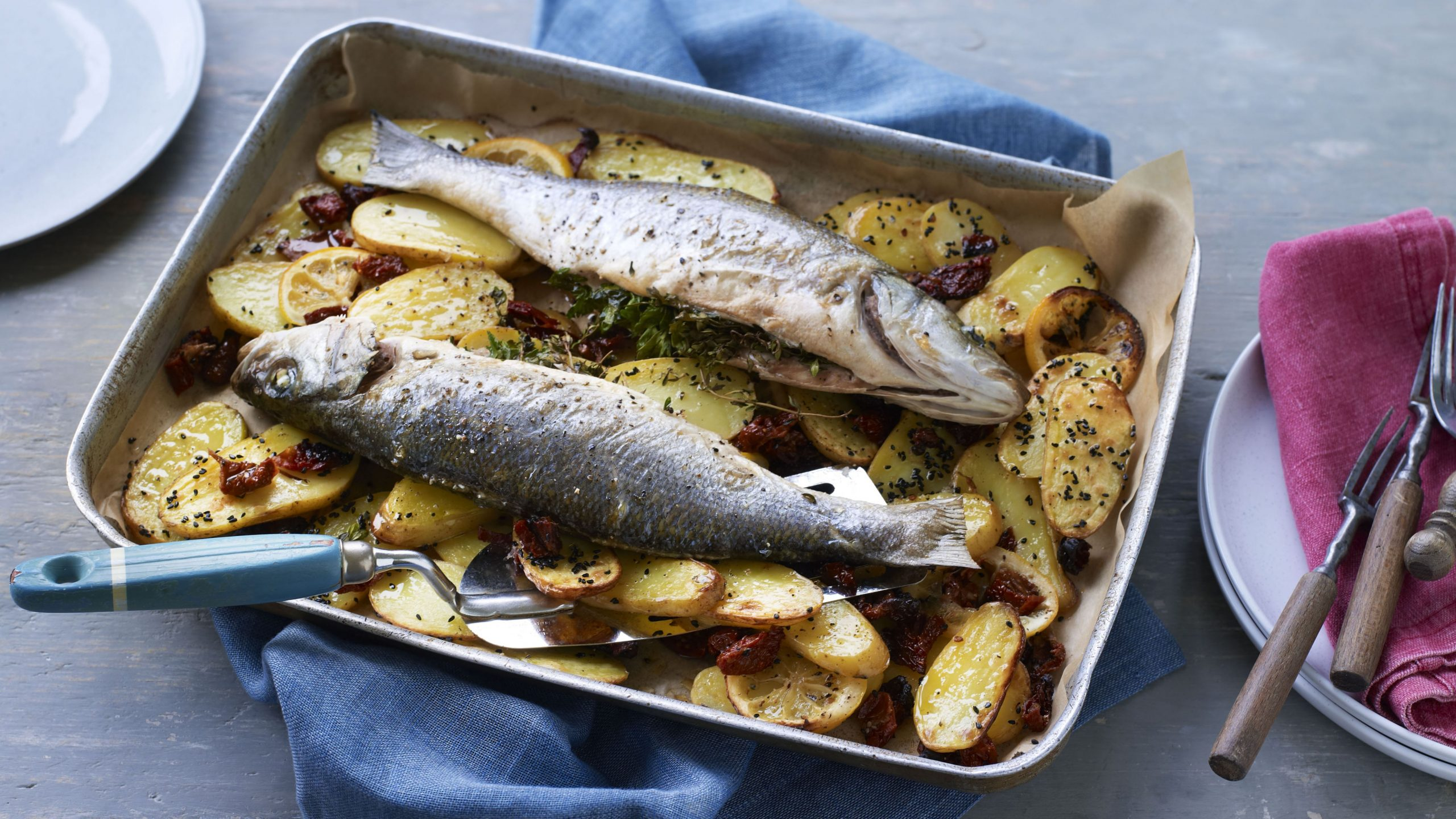 Whole baked fish with potatoes, lemon and sundried tomatoes - Recipes Fish In The Oven